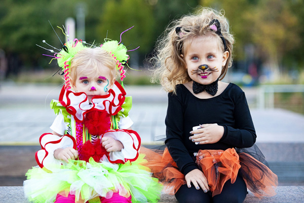 Two adorable girls, all dressed up for Halloween, enjoy Scream on the Green.